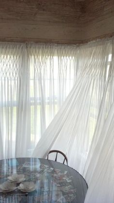 White Organdy Smocked Curtains  These fabulous curtain panels of sheer white organdy are beautifully hand smocked across the top. Perfect for lounge room with white chesterfield...yay!