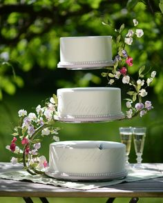 A Midsummer Night Dreams - Wedding cake with flowerpaste sweet peas wired to a s-shaped cake stand