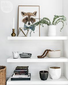 Too many tchotchkes and pieces of furniture can look messy, so the designers created a custom shelving unit, placed across from the living room sectional, to neatly display a few favourite things. | Image: Natalie Cinelli | Designer: Kate Krasic & Amanda Nycz/Kate + Amanda Design | #Accessories #Objets #DesignInspiration #StyleAtHome