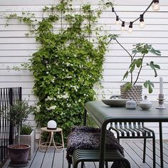Home tour: Janniche Bergstrom — 91 Magazine - lovely outside space in scandi style with garden furniture and festoon lighting Outdoor Seating, Outdoor Spaces, Outdoor Living, Outdoor Decor, Scandinavian Garden, Scandi Garden, Snow In Summer, Garden Spaces, Garden Inspiration