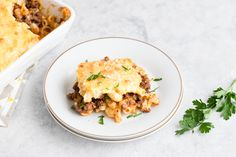 Pastitsio consists of luscious layers of baked seasoned ground beef, pasta, and a creamy bechamel sauce. This is Greek comfort food at its finest.