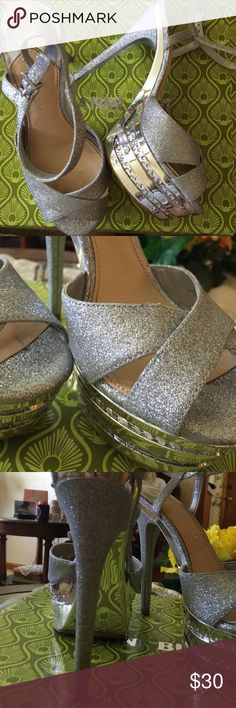 Gianni Bini extravagant high heels Beautiful silver sparkly fun & blingy high heels! Worn one time for prom! In mint condition! Gianni Bini Shoes Heels
