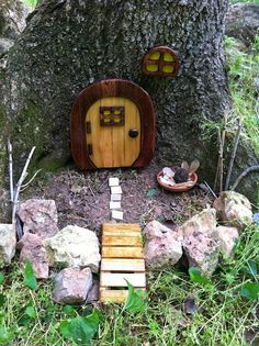Sweetly hidden fairy house.  Someday I want to figure out how geocaching works...from play create explore