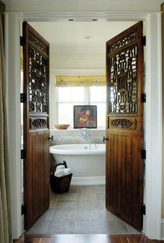 Exotic doors create dramatic entrance to bath; Herlong & Associates