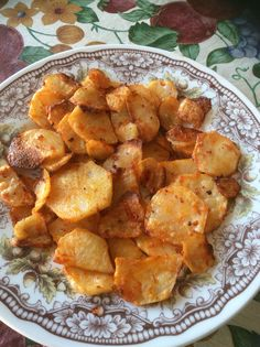 Home-made batata frita seasoned with garlic, paprika and Moho de Piri-Piri.
