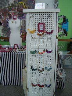 Displaying jewelry by amylcluck, via Flickr (general shop display for necklace displays?)