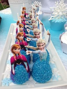 Talia's Frozen Winter Wonderland | CatchMyParty.com cake pops with paper figures added