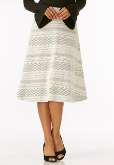 Go on a style adventure in this pull-on midi skirts, featuring a tribal jacquard fabrication and classic a-line silhouette.        67% cotton, 30% polyester, 3% spandex     Machine wash     Imported