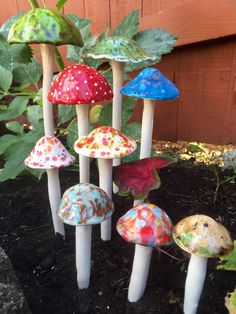 Nine hand crafted ceramic mushrooms, 2 extra large, 2 large, 2 medium, and 3…