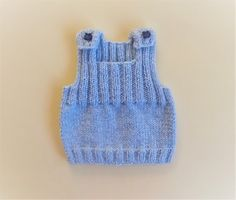 "Ribbed Baby Vest Top      Baby's Ribbed Vest Top         Size:    To fit a newborn baby              Width – 16""                  Length ..."