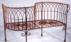 This Wrought Iron Bench is a Courting Bench. The seating for each person faces out toward the opposite direction. Years ago these benches were used by