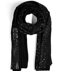 Shimmering black sequin embellishment lends glamorous sparkle to this soft cashmere scarf from Donna Karan #Stylebop