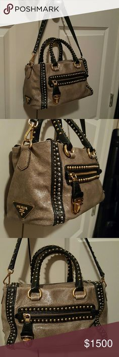 Prada bag Stunning Prada bag! It's made in a distressed leather and is gorgeous! All gold studs in tact and 4 gold feet on bottom. The studded shoulder strap is detachable.  Taupe color with black. Authentic as always and comes with Prada dust bag. Prada Bags Totes