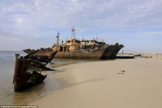 Ship wrecks rusting on the shores of the beach of Nouadhibou, one of the largest ship wreck cemeteries worldwide, Mauritania, north-western Africa