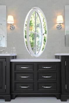 Wow! Oval pivot window?  Cabinets, hardware and tile are just beautiful.