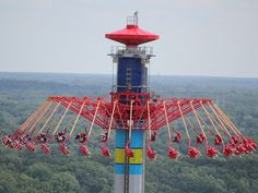 Kings Island is a 364-acre amusement park located in Mason, Ohio. It features over 80 rides, shows and attractions including 14 roller coasters and a 33-acre (13 ha) water park.  (Pictured: Windseeker, 300 feet in the air...)