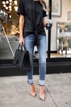 Hate the hem on the jeans, but the loose black tee, with some skinnies and nude heels is