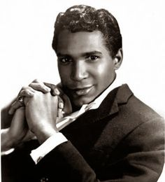 Adam Wade June 16, 1975 Adam Wade hosts the Nationally televised game show Musical Chairs. He is the first African American game show host.