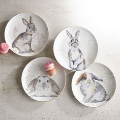 Invite our bevy of furry friends to your next to-do. A quartet of adorable gray bunnies on botanical backgrounds grace these porcelain plates with a gilded rim for a gorgeous finishing touch.