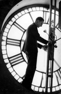 1946: Herbert Palmer adjusts the clock at the Melbourne Town Hall. Picture: Herald Sun Image Library