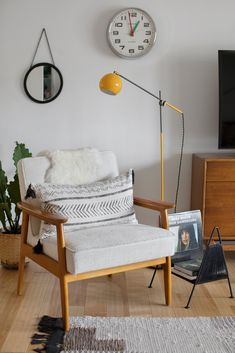 The Mid Century Modern Micheil Tufted Armchair is France&Son and the Studio Floor Lamp is Schoolhouse Electric. The TV stand is a thrift find.