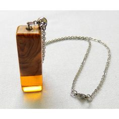 wood and translucent resin necklace ($23) ❤ liked on Polyvore featuring jewelry, necklaces, wooden necklaces, wooden jewelry, wooden chain necklace, wood resin jewelry and resin chain necklace