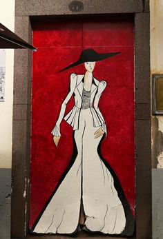 Lady in White. Painted door. Madeira, Portugal.