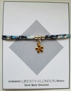 Liberty of London fabric jewellery from Mums Jewellery Shed on Facebook.  Gold plated flower on bail