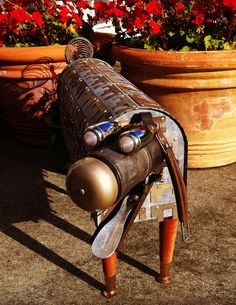 NZ$950 Approx 75mm long 40cm high Robo-dog made from… Mail box 1960's sofa legs Miner's lamp head Door bell nose Car light eyes Shoe horn tongue Suitcase handle ears French whisk tail