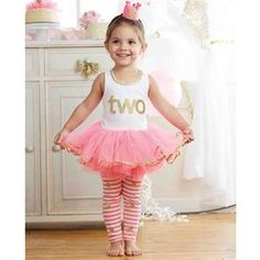 2-piece set. Cotton tank features glitter applique with ric-rac and mesh skirt. Comes with printed glitter dot leggings. Dimensions: i'm two | 2T