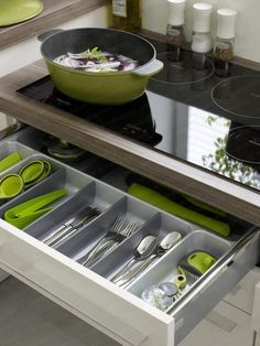 I think a drawer like this right below the cooktop would be nice, but I would store cooking utensils in it; e.g. spatulas, ladles, etc