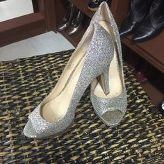 Beautiful silver heels Absolutely gorgeous silver heels with a little gold glitterExcellent condition and ready to rock a new owner International Concepts Shoes Heels
