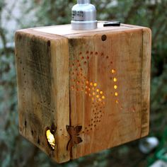 Recycled wood light - I would make this into a pillar light with butterflies, ladybugs, and dragonflies for lighting accents in my backyard landscaping :)