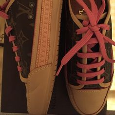 Louis Vuitton, pink laces THE cutest Louie's ever! In wonderful condition with the LV logo & pink laces. Shoes