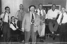 PHOTO FROM ARCHIVE OF HOT CLUB OF FRANCE Guy Lafitte, Andre Persiani , Mowgil Jospin, Hughes Panassie, Lee Collins, Zutty Singleton, Milton Mezz Mezzrow