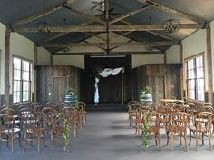 Rustic wedding ceremony perfection. Timber 2 post arbor and beautiful bentwood chairs