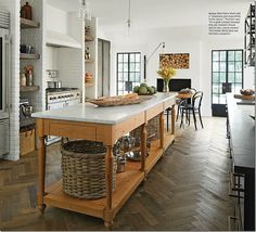 Country style, love the size of island, the beautiful wooden floor, and crittal doors.