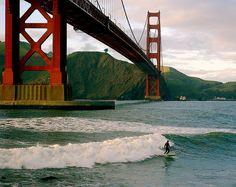 Sunset surfer under Golden Gate Bridge by 2composers, via Flickr