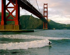 Sunset surfer under Golden Gate Bridge by 2composers, via Flickr