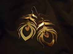 I finally got them finished! Brass and copper peacock feather earrings. Hand cut, filed, and polished.