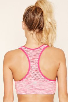8e9f4de9d9 A space dye low-impact sports bra crafted from seamless knit with a  perforated racerback