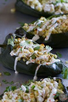 Flavor explosion! These Chicken and Corn Stuffed Chiles are packed with flavor - chicken, corn, cheese and salsa all inside a mild poblano pepper. Don't skip the lime cream!