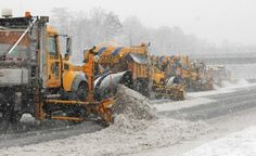 Department of Transportation trucks plow along the eastbound Long Island Expressway between exits 58 and 59 in Islandia on Monday, Feb. 3, 2014. (Credit: James Carbone)