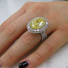 10.08 TCW 18K White Gold Fancy Intense Yellow Oval Cut Certified Diamond Ring #SageDesigns #SolitairewithAccents