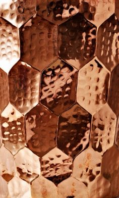 Hammered Copper. I Like this. I should use these shapes for a wind chime .