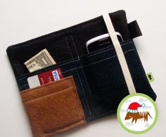 This handmade, TLC Pouch is a multi-use cell phone case and wallet. Carry your phone, money, cards and other good stuff all in one easy and convenient place!