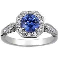 Antique-style sapphire with halo and filigree details. I want this ring so very much.