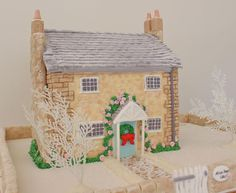 My Little English Cottage 'Sugar House' by Alison Lawson Cakes (7/16/2012)  View cake details here: http://cakesdecor.com/cakes/21931