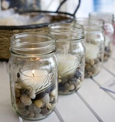 Pebble Stones in Ball Jar with Candles. Cute, simple, kind of rustic idea for decorating.I'm gonna use citronella candles for the deck.