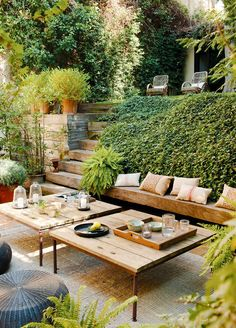 All wood entertaining area built-in to lush green backyard landscape.